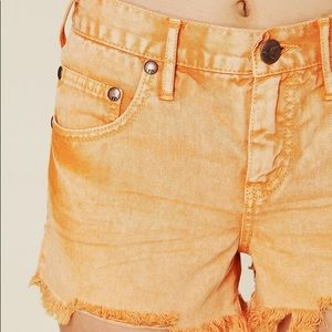 Free People Distressed orange denim cut off short